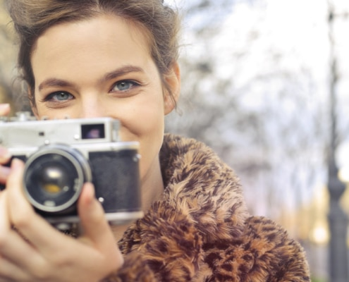 pretty girl holding a camera
