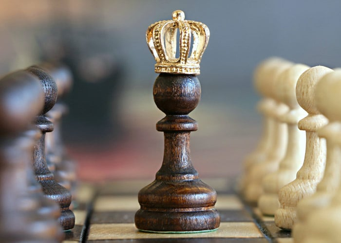 chess pieces with king in sharp focus