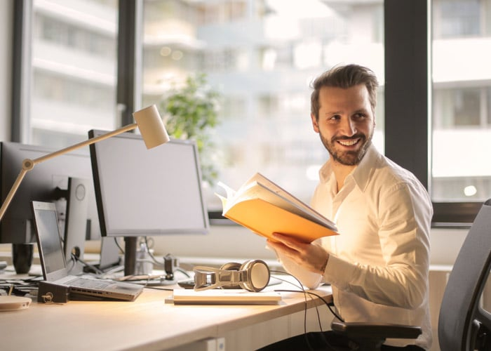 Young man at his desk in office