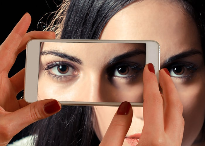 mobile phone screen showing photo of young lady
